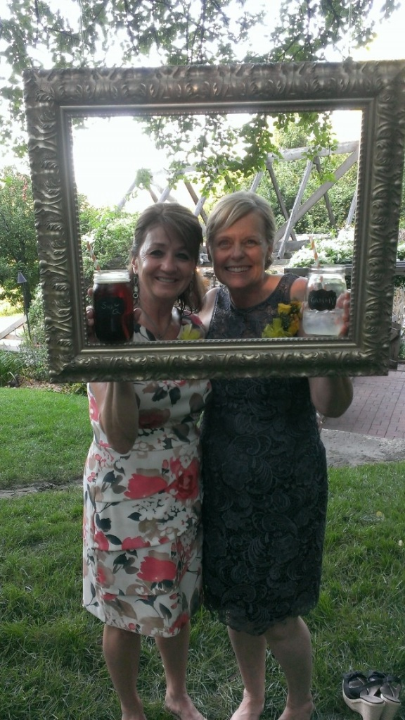 We hung a picture frame from a tree branch for silly pictures during the social hour (between the ceremony and dinner).  HUGE SUCCESS for our guests!