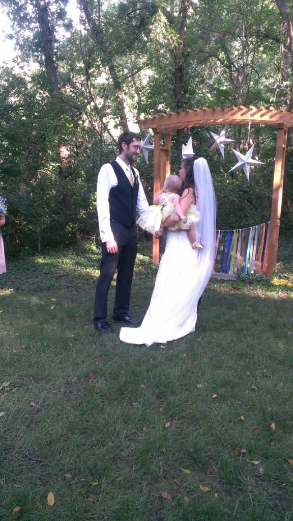 Exchange of Vows for Drew & Jessi.  (Maggie was fussy and was only comfortable in Mommy's arms.)